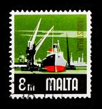 Industry, Ship and crane, Aspects of Malta serie, circa 1973. MOSCOW, RUSSIA - OCTOBER 3, 2017: A stamp printed in Malta shows Industry, Ship and crane, Aspects Royalty Free Stock Photos