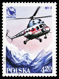 MI-2 helicopter over mountains, Polish Sport Planes serie, circa 1978. MOSCOW, RUSSIA - OCTOBER 6, 2018: A stamp printed in Poland shows MI-2 helicopter over royalty free stock images