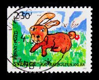 Rabbit, Children's Drawings serie, circa 1992. MOSCOW, RUSSIA - OCTOBER 3, 2017: A stamp printed in shows Rabbit, Children's Drawings serie, circa royalty free stock image