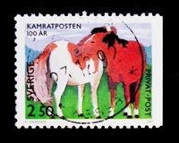 Horses, Children's Drawings serie, circa 1992. MOSCOW, RUSSIA - OCTOBER 3, 2017: A stamp printed in Sweden shows Horses, Children's Drawings serie royalty free stock images