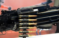 Tape with live ammunition in a machine gun. royalty free stock photo
