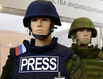 Unified modular bulletproof vest for journalists `ZHUK`. MOSCOW, RUSSIA - OCTOBER 20, 2015: Unified modular bulletproof vest for journalists `ZHUK Royalty Free Stock Photo