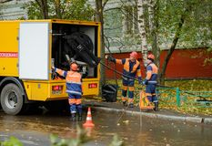 Workers conduct water pipe repair work in the street Stock Photos