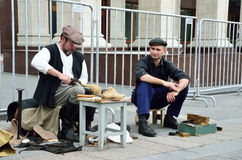 Moscow, Russia, June, 12, 2017, Participants of the festival `Times and epochs` on Manezhnaya square, the cobbler and shoe shiner. Moscow, Russia, participants stock photos