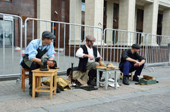 Moscow, Russia, June, 12, 2017, Participants of the festival `Times and epochs` on Manezhnaya square, the cobbler and shoe shiner. Moscow, Russia, participants royalty free stock image