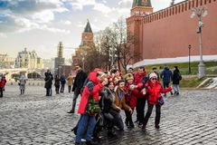 Moscow, Russia. Red Square, autumn. Cheerful tourists and travelers are photographed for a good mood. Moscow, Russia. Red Square, autumn. Cheerful tourists and royalty free stock image