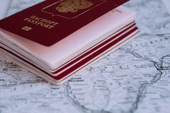 Moscow, Russia - 05 10 2018 Russian foreign passports over map. Moscow, Russia - 05 10 2018 Russian passports over the map, visa stamp royalty free stock image
