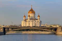 Moscow, Russia - September 02, 2018: Cathedral of Christ the Saviour in Moscow against Moskva river and Bolshoy Kamennyi Bridge in royalty free stock images