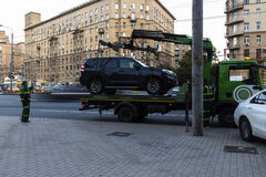 Moscow;Russia,September -first-Two thousand sixteen year;working of  tow truck  ,car evacuation for parking violation. In  September -first-Two thousand Stock Photography