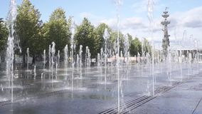 Fountain in Muzeon Park on Krymskaya Naberezhnaya in central Moscow. In the background monument to Peter the Great - first Russian