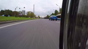 MOSCOW. RUSSIA - September 2016. Motorcycle is moving around the city. The camera is located at lower asphalt stock video