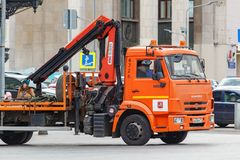 Moscow, Russia - September 30, 2018: Municipal tow truck with orange driver cabin on Manezhnaya Square in central Moscow stock photography