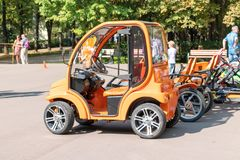 MOSCOW, RUSSIA - SEPTEMBER 02, 2018: Orange electric cars and four-wheelers in park for rent stock images