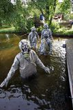 MOSCOW, RUSSIA - SEPTEMBER 18.2004: People in protective suits a. Nd gas masks are moving in the water during the exercise of civil defense Royalty Free Stock Photo