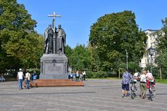 Moscow, Russia, September, 01, 2018. People walking next to the monument to Cyril and Methodius on Slavyanskaya square in autumn. Moscow, Russia. People walking stock photos