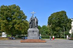 Moscow, Russia, September, 01, 2018. People walking next to the monument to Cyril and Methodius on Slavyanskaya square in autumn. Moscow, Russia. People walking stock images