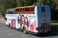 Moscow, Russia -September 21. 2015. Sightseeing bus with advertising on Bolotnaya Square Stock Images