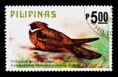 Great Eared-nightjar Lyncornis macrotis, Fauna - Birds serie, circa 1979. MOSCOW, RUSSIA - SEPTEMBER 3, 2017: A stamp printed in Philippines shows Great Eared Stock Photos