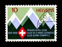 Stylized mountains and club badge, Swiss Women Alpine Club, circa 1968 Stock Photos
