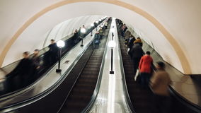 MOSCOW, RUSSIA - 28 SEPTEMBER 2016: Timelapse people moving escalator on Kievskaya subway station. MOSCOW, RUSSIA - 28 SEPTEMBER 2016: Timelapse view of people stock video