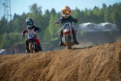 Motorcycle racer on top of a hill. MOSCOW, RUSSIA - SEPTEMBER 15, 2018: Unrecognized young athletes,in the Velyaminovo Race Weekend 2018, Motopark Velyaminovo stock image