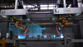 Moscow, Russia - September, 2018: Welding robots movement in car factory. Scene. Movement of robot when welding with royalty free stock images