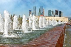 Fountain in Victory Park in Moscow with a view of the towers of stock images