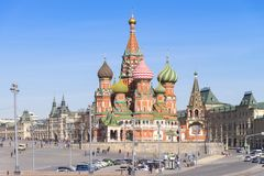 Moscow,Russia, St. Basil& x27;s Cathedral and Kremlin Walls and Tower stock photography