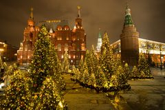 Moscow, Russia. State Historical Museum And Moscow Kremlin With. Beautiful Decorated Christmas Trees At Manege Square Evening Winter In Moscow Royalty Free Stock Photography