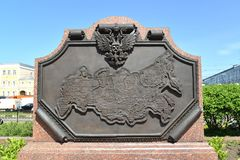 MOSCOW, RUSSIA. A stele with the bronze Russia map in the square at Komsomolskaya Square. MOSCOW, RUSSIA - MAY 14, 2018: A stele with the bronze Russia map in royalty free stock photos