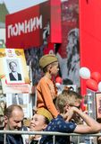Victory Day in Moscow.a boy in a military pilot`s cap sits on his father`s shoulders. 2018.09.05, Moscow, Russia. Victory Day in Moscow.a boy in a military stock image