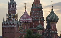 Moscow Russia View on Kremlin Towers and St  Basil Cathedral. On against cloudy sky royalty free stock photography