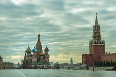 Moscow / Russia - 04.2019: View of the Red Square with St. Basil`s Cathedral and the Kremlin`s Spassky Tower royalty free stock photos