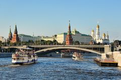 Approaching Bolshoy Kamenny Bridge. MOSCOW, RUSSIA - View from a riverboat on other boats approaching Bolshoy Kamenny Bridge in the background of the magnificent stock images