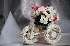Moscow, Russia - 06 10 2018: wicker stand for flowers in the shape of a Bicycle, home decor, cozy room,interior design royalty free stock photography