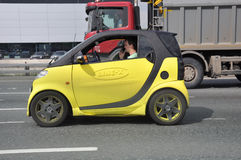 MOSCOW, RUSSIA - 29.05.2015. Yellow Smart Car with advertising Line-x on Moscow Ring Road Royalty Free Stock Photo