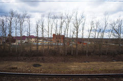 Moscow, Russian federal city, Russian Federation, Russia. Russia, 23/04/2017: the landscape of the suburbs of Moscow and train tracks seen from the Aeroexpress Royalty Free Stock Images