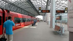 Aeroexpress train in the Sheremetyevo airport terminal D. Moscow, Russian Federation - August 07,2015: Aeroexpress train in the Sheremetyevo airport terminal D stock footage