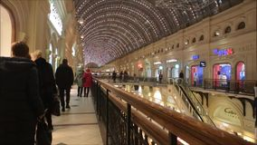 Moscow, Russian Federation - January 28, 2017: The interior of famous GUM State Department Stores with many shops and people stock video footage