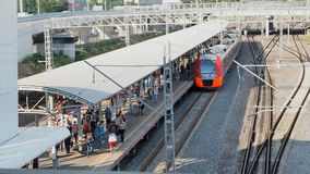Moscow, Russian Federation July 11, 2017: Train departure from the station. People left the overground train and walked. To the exit stock video