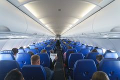 Interior of airplane with passengers on seats. Stock Photography