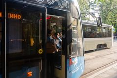 Moscow, Russian Federation, May 06 2019. the passenger buys a ticket in the Moscow modern tram from the tram driver. The tram is stock image