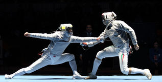 Moscow Saber World Fencing Tournament. Duel for Cup Grand Prix event, Eun S.Oh (KOR) and Zsolt Nemcsik (HUN) compete at the 2010 RFF Moscow Saber World Fencing royalty free stock image