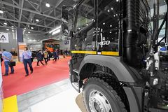 MOSCOW, SEP, 5, 2017: View on exhibit black Volvo 460 tipper truck and people on exhibition Mining World 2018. Commercial trucks f stock photography