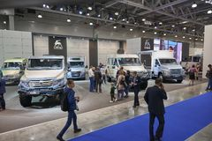 MOSCOW, SEP, 5, 2017: View on GAZ stand with cars vehicles and mud trucks for hard to reach areas. Off road trucks for civil cargo. Transportation. Commercial Royalty Free Stock Photos