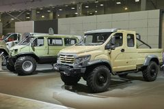 MOSCOW, SEP, 5, 2017: View on special custom off-road mud trucks GAZ for hard to reach areas. Off road cargo trucks for civil mili. Tary transportation Stock Images
