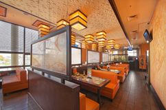 MOSCOW - SEPTEMBER 2014: The interior of the popular Japanese sushi restaurant Stock Photos
