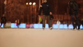 Moscow. Skating rink in the open air. People skate in the winter. Evening time. Christmas lights. Fast shooting. stock video footage