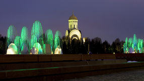 Moscow, St. George church and electric fountains Royalty Free Stock Image