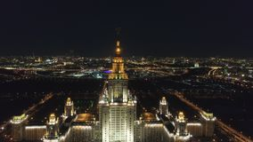 Moscow State University and Illuminated Moscow Skyline at Night. Russia. Aerial View. Moscow State University Main Campus and Illuminated Moscow Skyline at Clear stock video